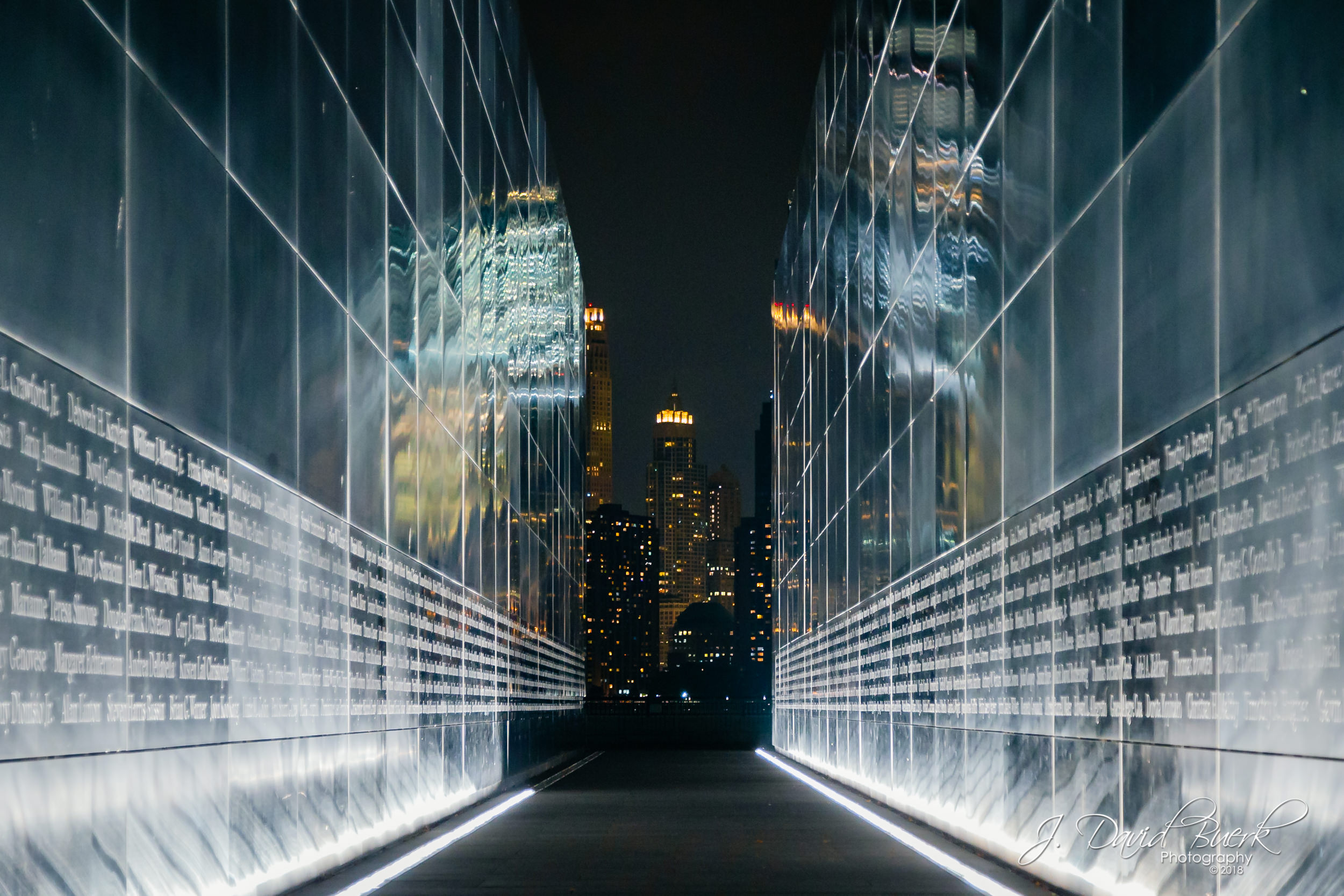 Nighttime view of the former location of New York City's World Trade Center Twin Towers through the Empty Sky Memorial in Jersey City, New Jersey.