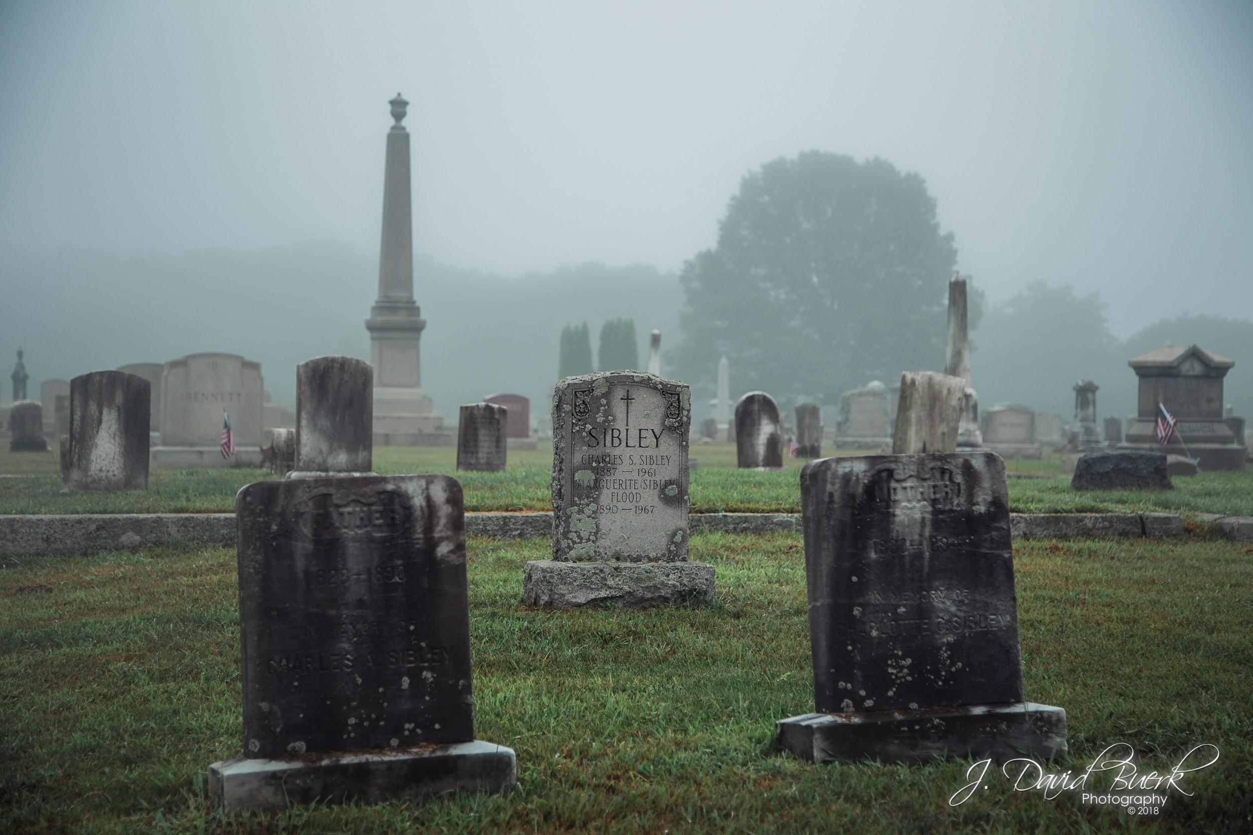Headstones in the fog, seen in Union Cemetery, North Smithfield, Rhode Island.