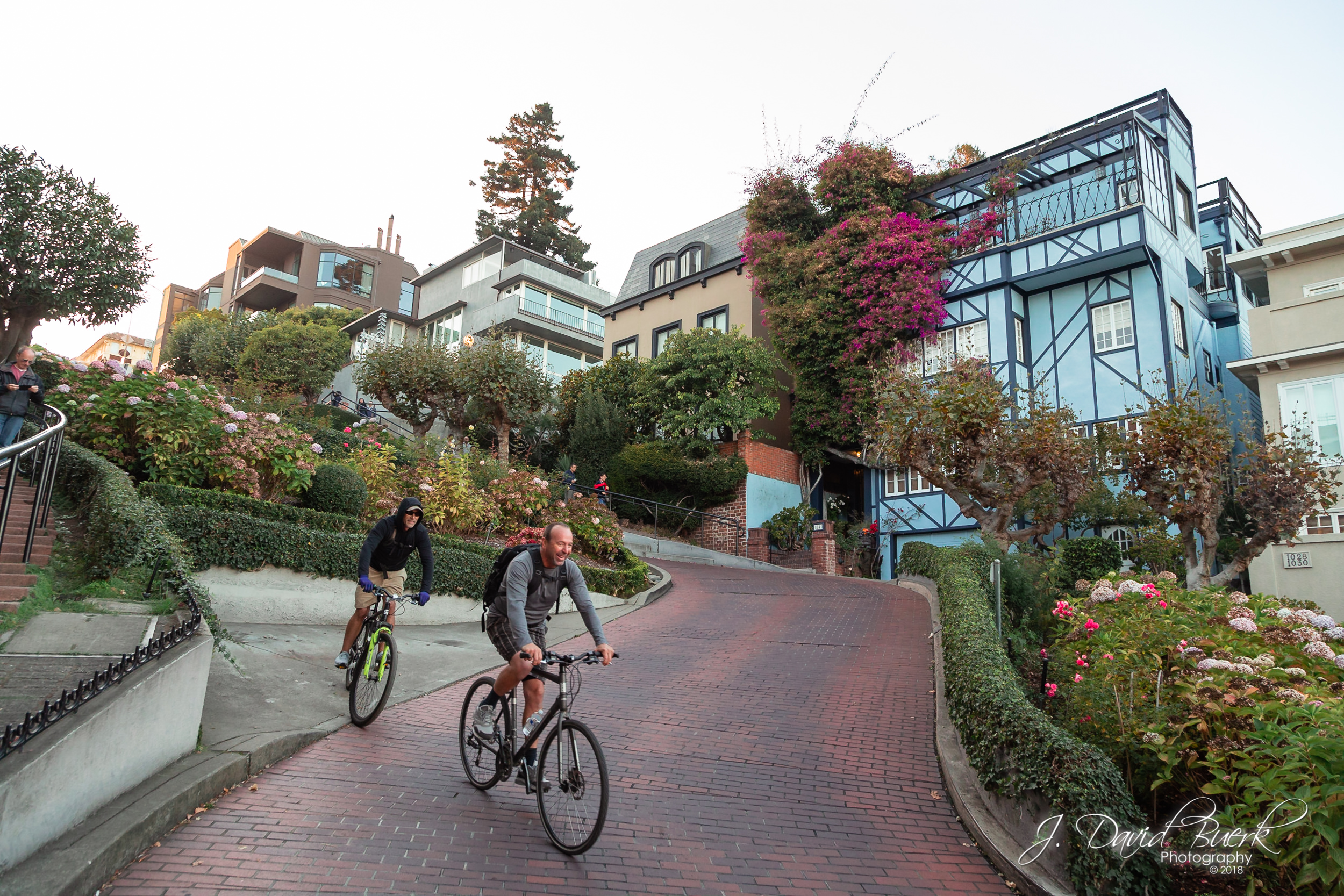 Cyclists biking down the chicanes of Lombard Street, San Francisco, California.