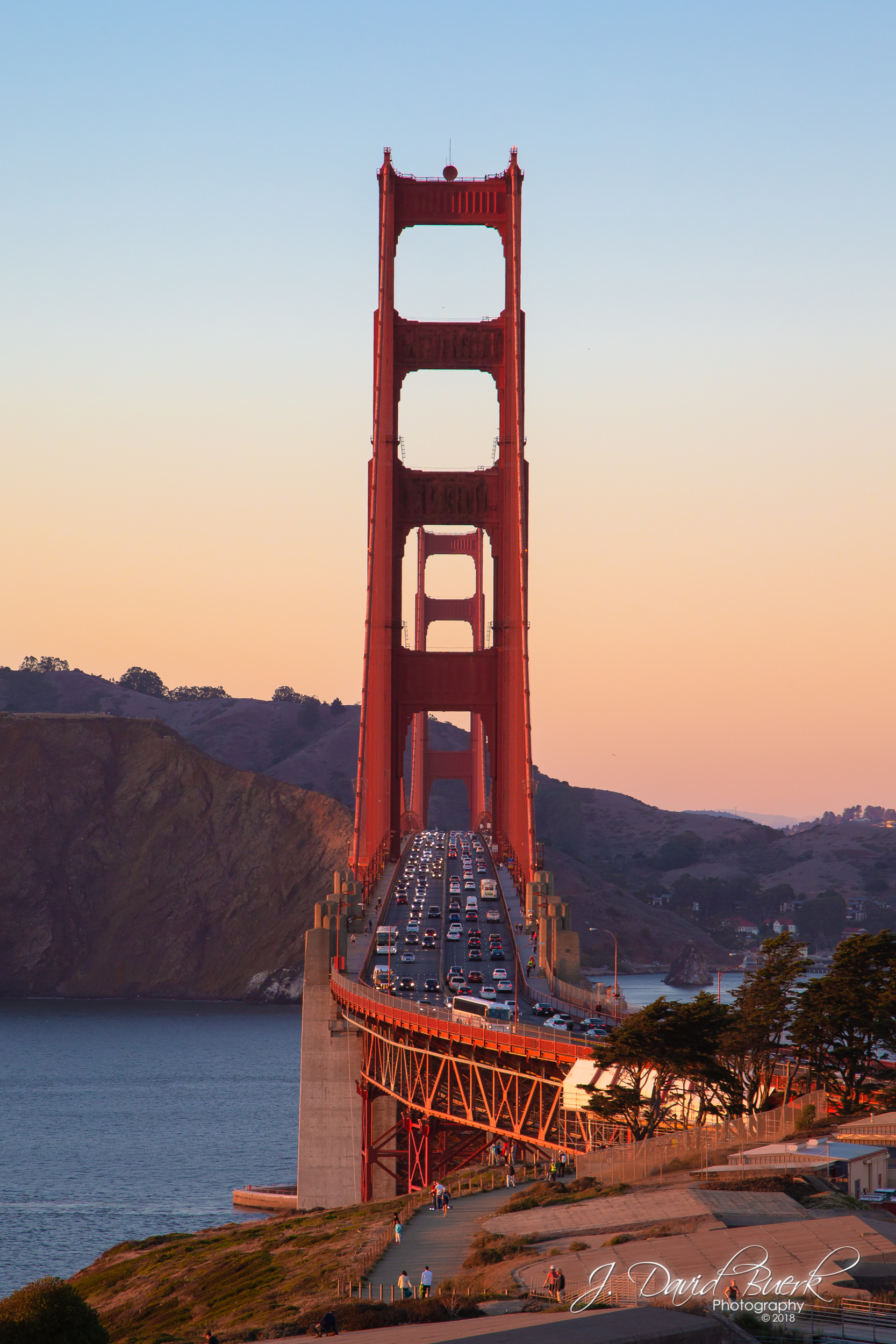 San Francisco's iconic Golden Gate Bridge at sunset.
