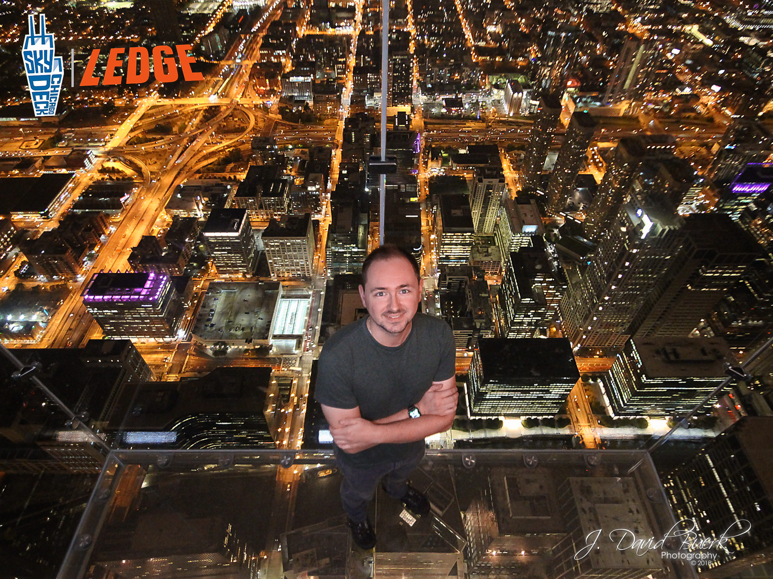 "Myself standing in Willis Tower's ""Sky Deck Ledge,"" the tallest point above Chicago, Illinois."