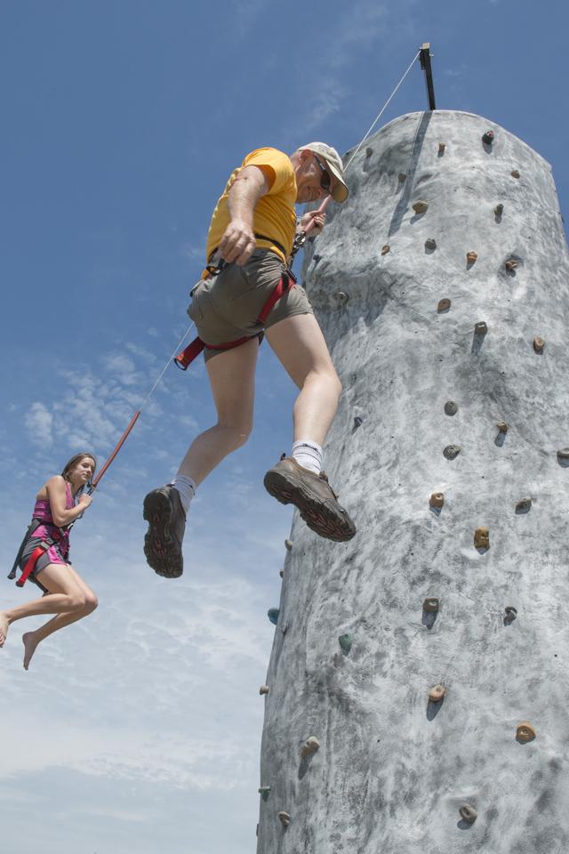 Attendees enjoying some rock climbing