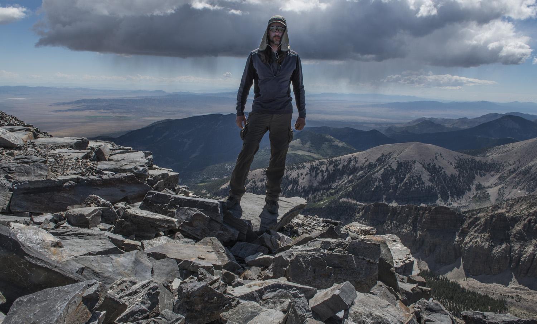On the summit of Wheeler Peak. Notice the rain in the background.
