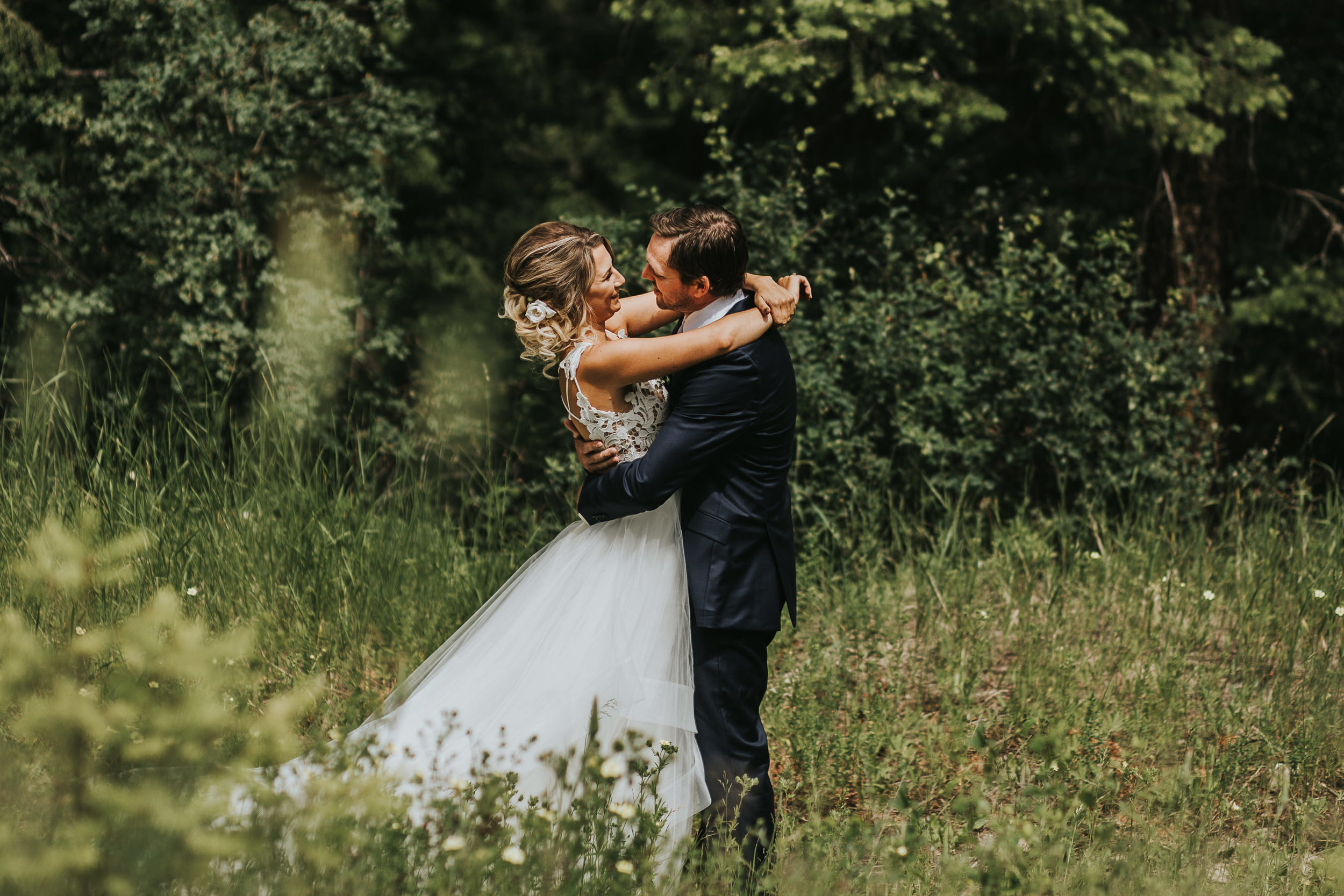 Boho Bride and Groom Dancing in Wildflowers Canmore Wedding