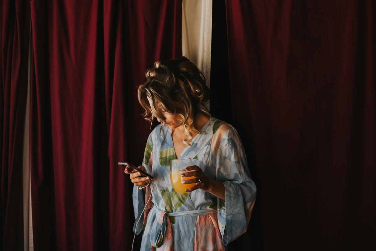 Bride floral robe candid getting ready Alberta ranch wedding