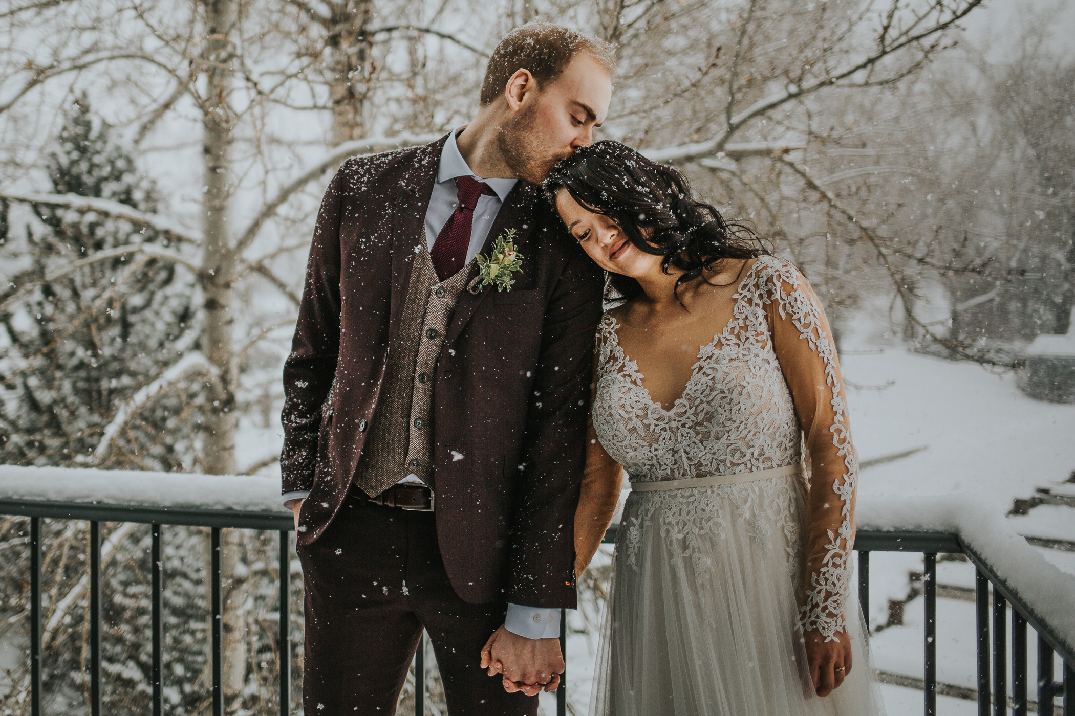 Calgary Alberta Winter Wedding Bride and Groom in the snow the Lake House