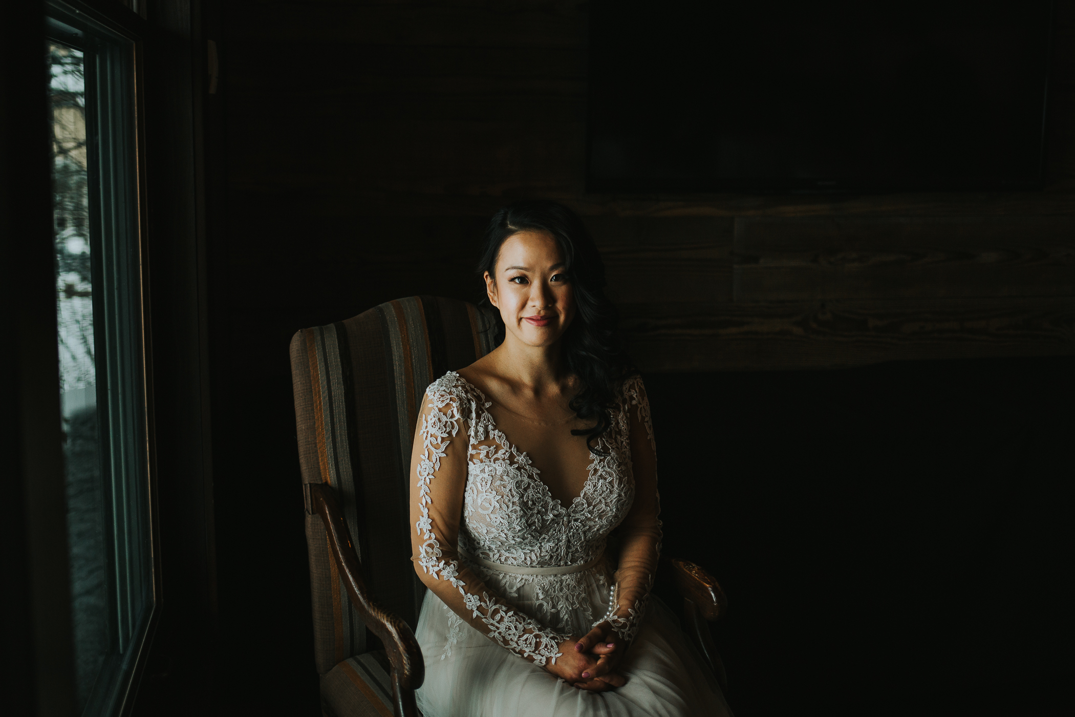 Calgary Alberta winter wedding moody bridal portrait lace sleeve dress