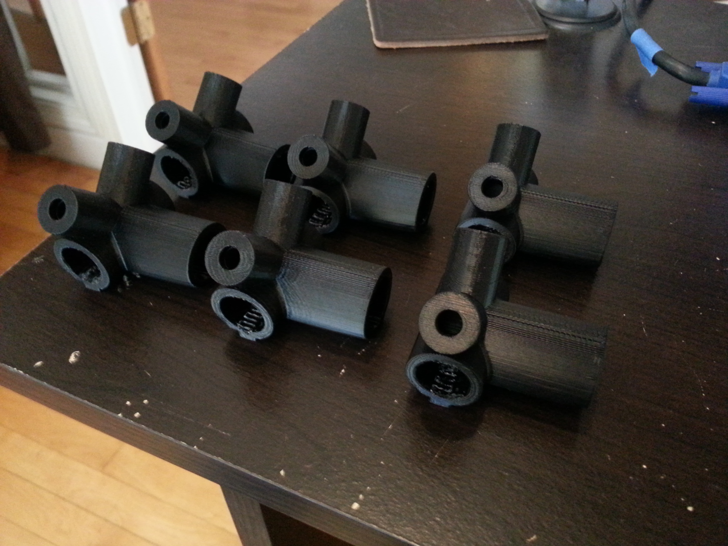 4 Black ABS and 2 Black PLA T-Brackets