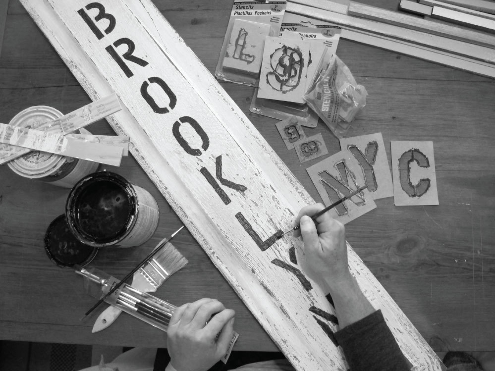 Teri is turning a salvaged raised panel into a Brooklyn sign