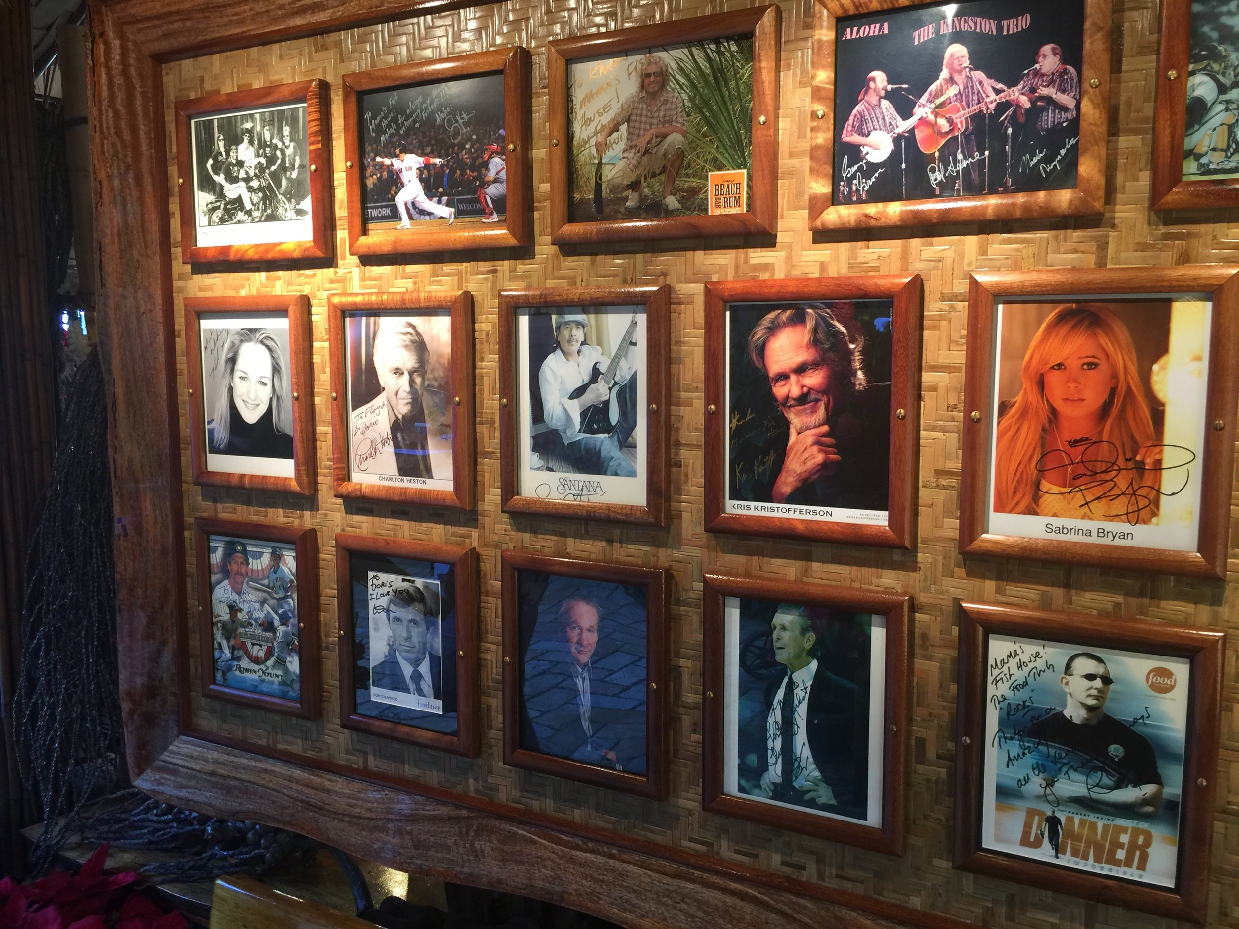 In the waiting area the walls are adorned with photos of celebrities who have dined here