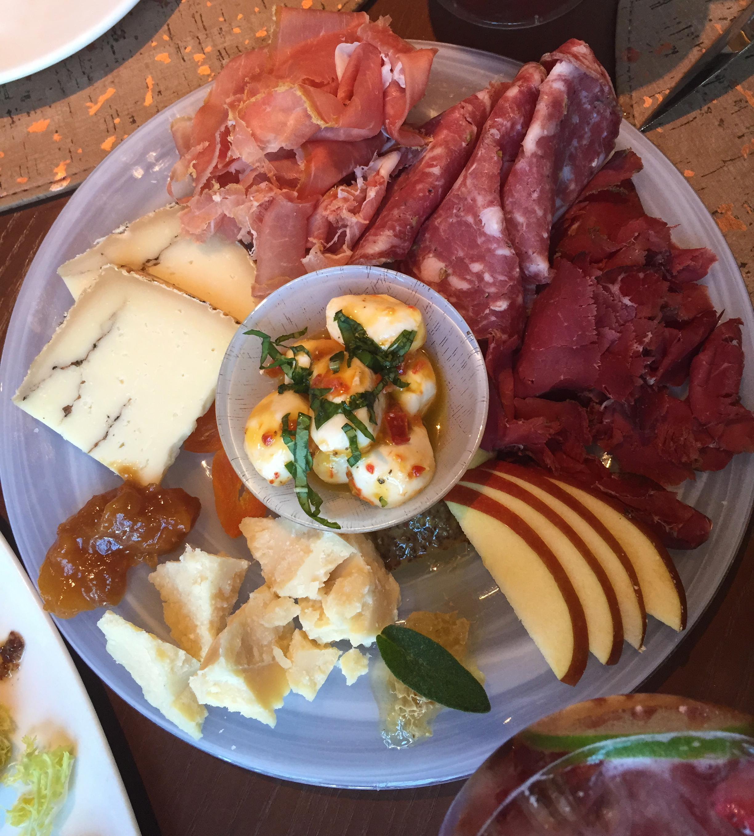 A selection of salumi, prosciutto, cheeses and fruit