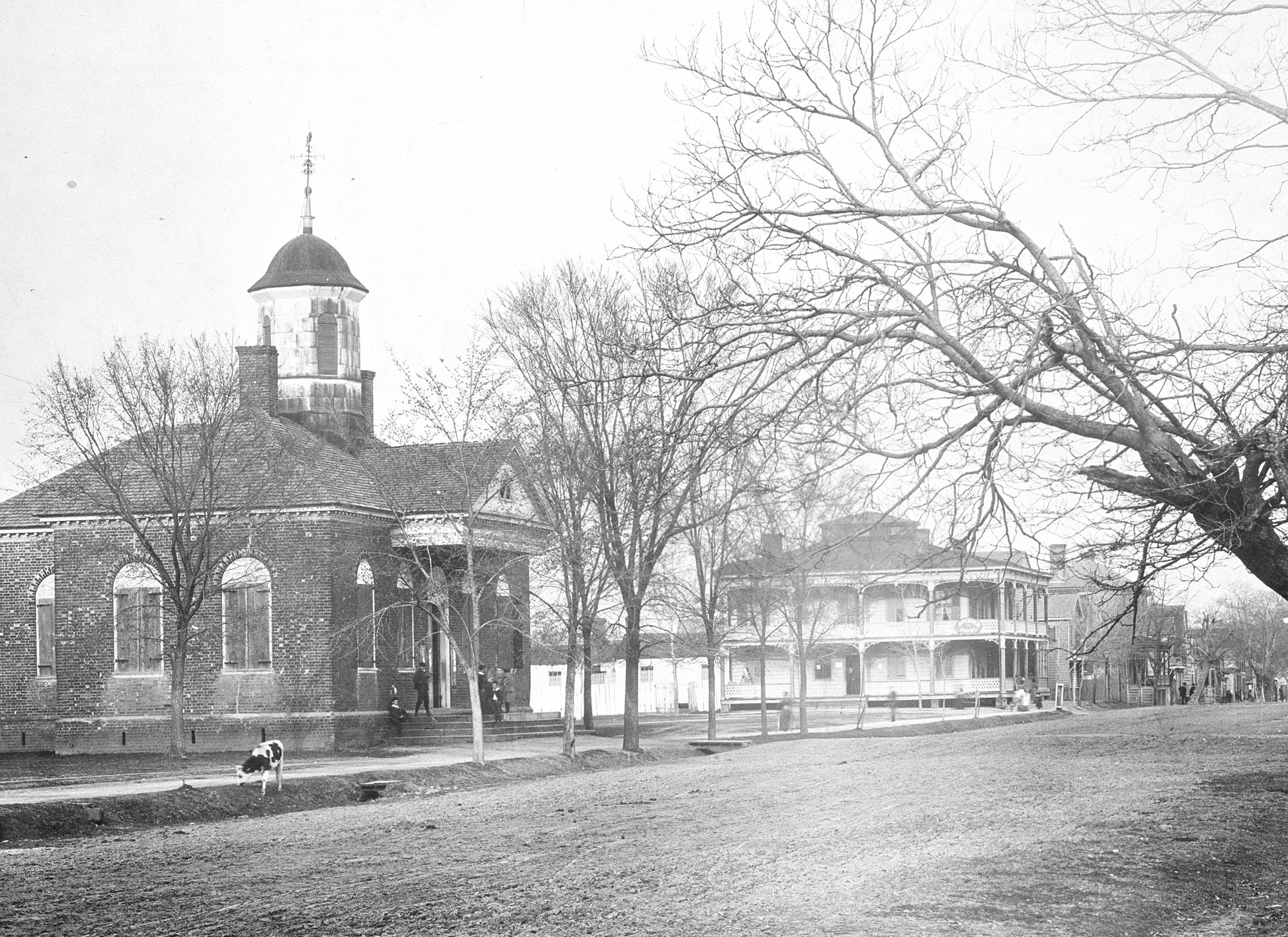 View looking east on Main Street of the 1770 Courthouse and Spencer Hotel (Mr. Harrell's Lodging House in 1860), ca. 1890s