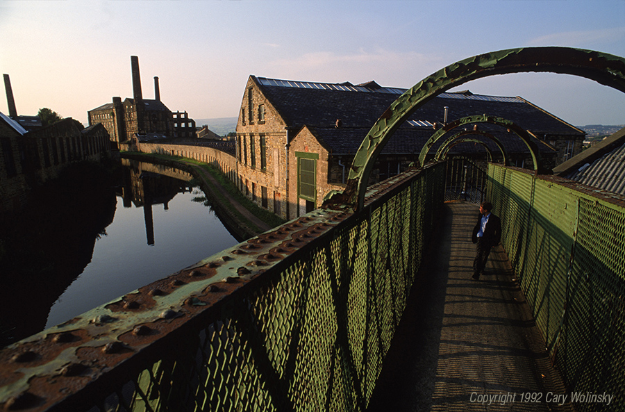 Defunct old cotton mills along the Leeds and Liverpool Canal in Burnley, England.