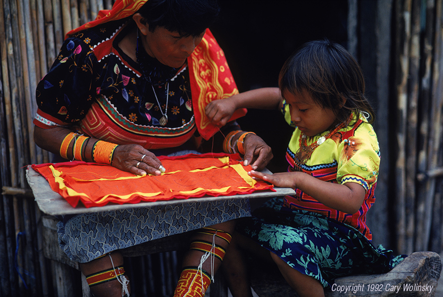A little Kuna Indian girl learning to stitch molas from her mother, in San Blas, Panama.