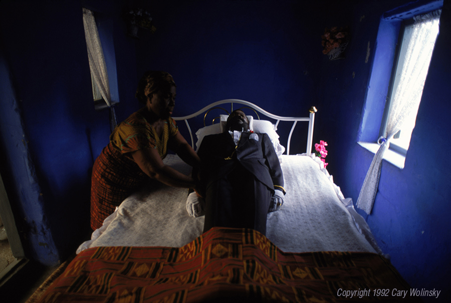 A woman prepares a body for burial in Accra, Ghana, Africa.