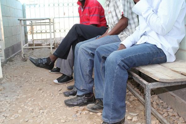 Men wait to be circumcised in Lusaka, Zambia. Photo: Catherine de Lange