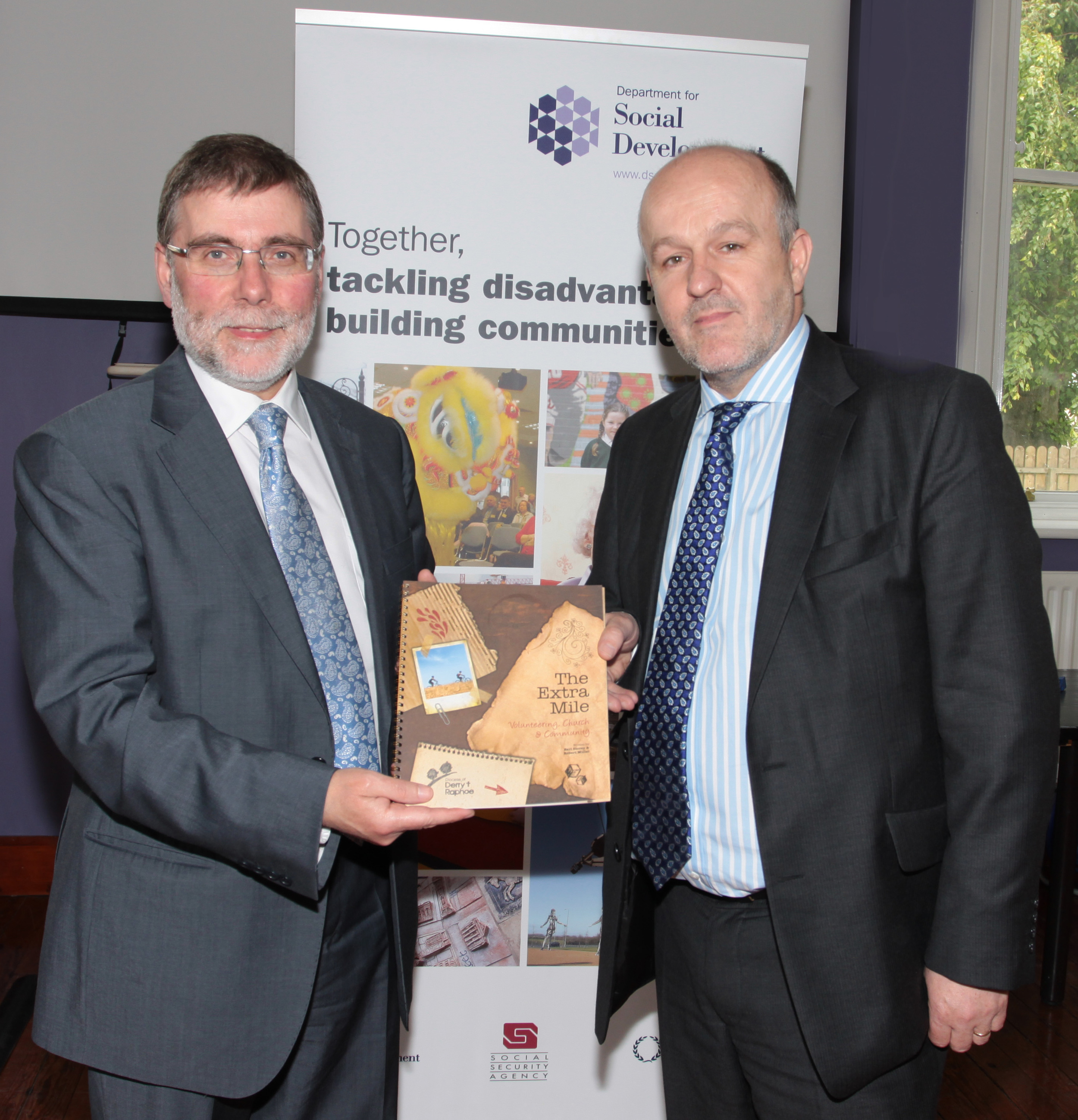 Minister Nelson McCausland MLA receives 'The Extra Mile'