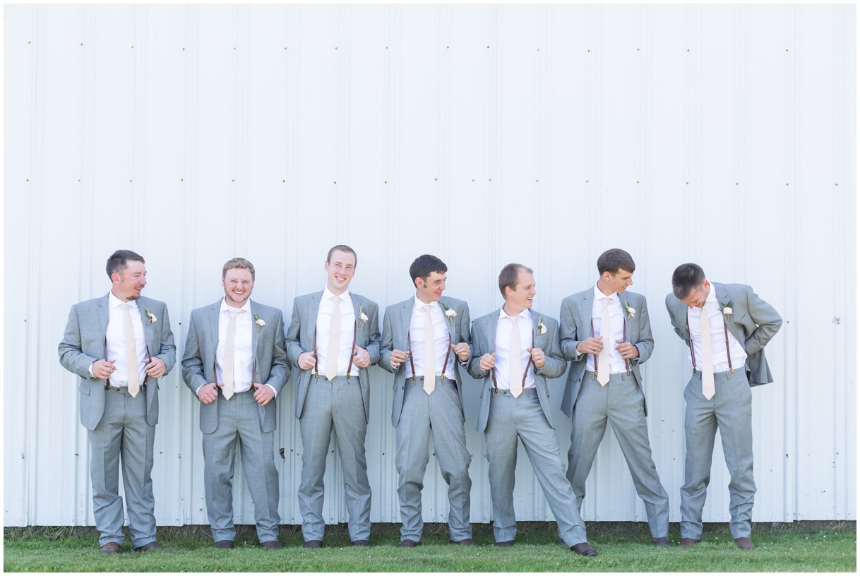 Groom and goomsmen getting ready at Lancaster farm wedding in summer photo