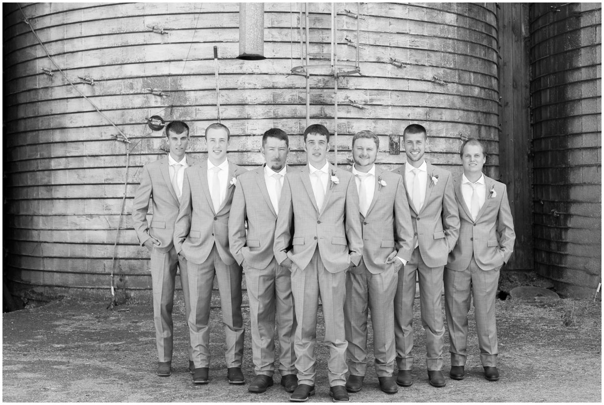 Black and white groomsmen image of Lancaster PA farm wedding in summer photo