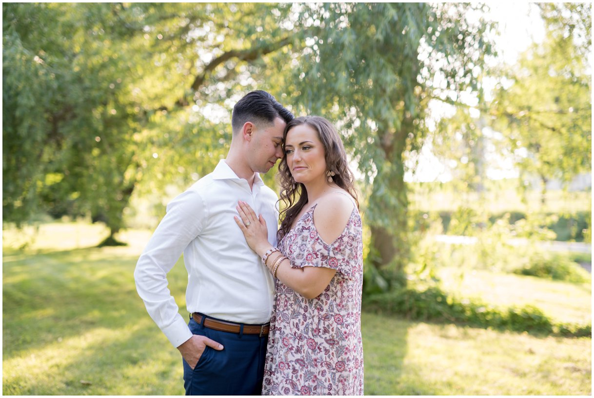 Lancaster PA engagement session at golden hour by mill and willow tree photo
