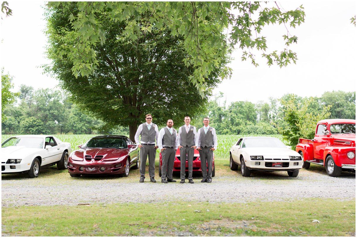 Groom and muscle cars at Pheasant Run Bed and Breakfast Lancaster PA on wedding day photo