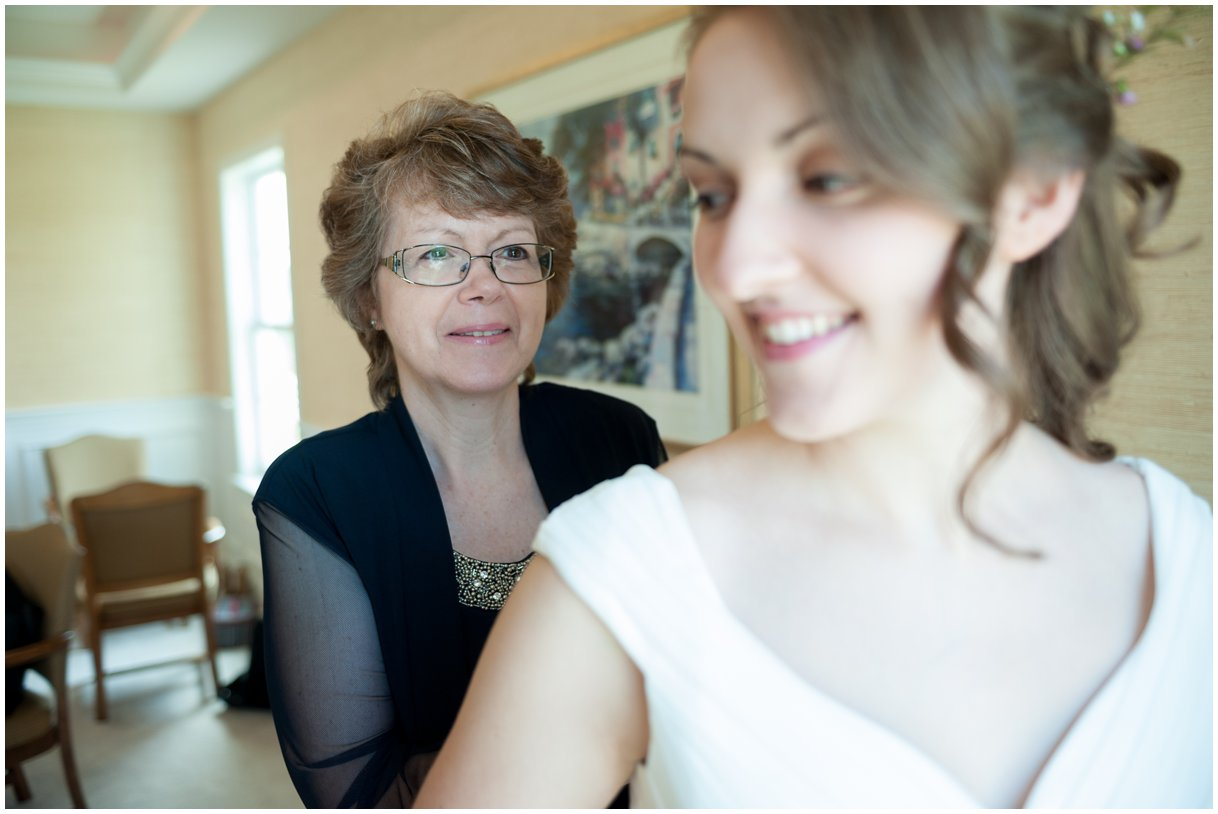 Bride and mom getting into dress wedding day Lancaster PA photo