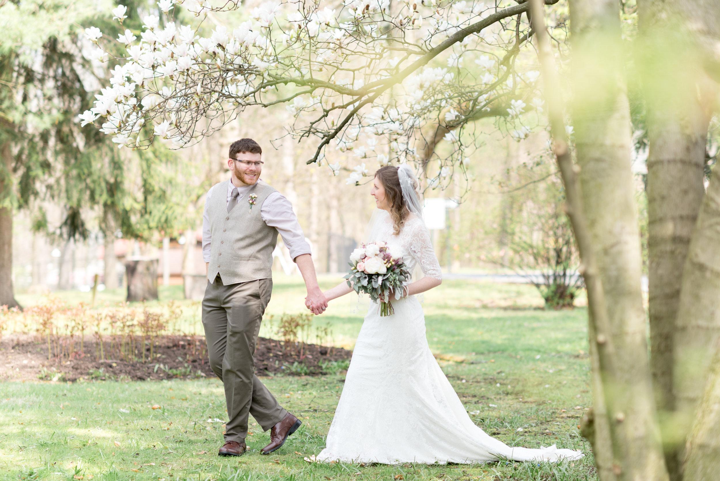 Bride-and-groom-walking-hand-in-hand-coleman-memorial-park-Lebanon-Wedding-Photograher