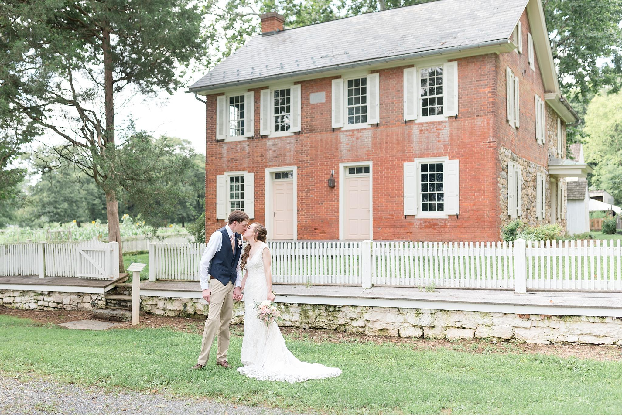 Romantic Summer wedding Landis Valley Museum Lancaster PA wedding photography John Deere Tractor_1950.jpg