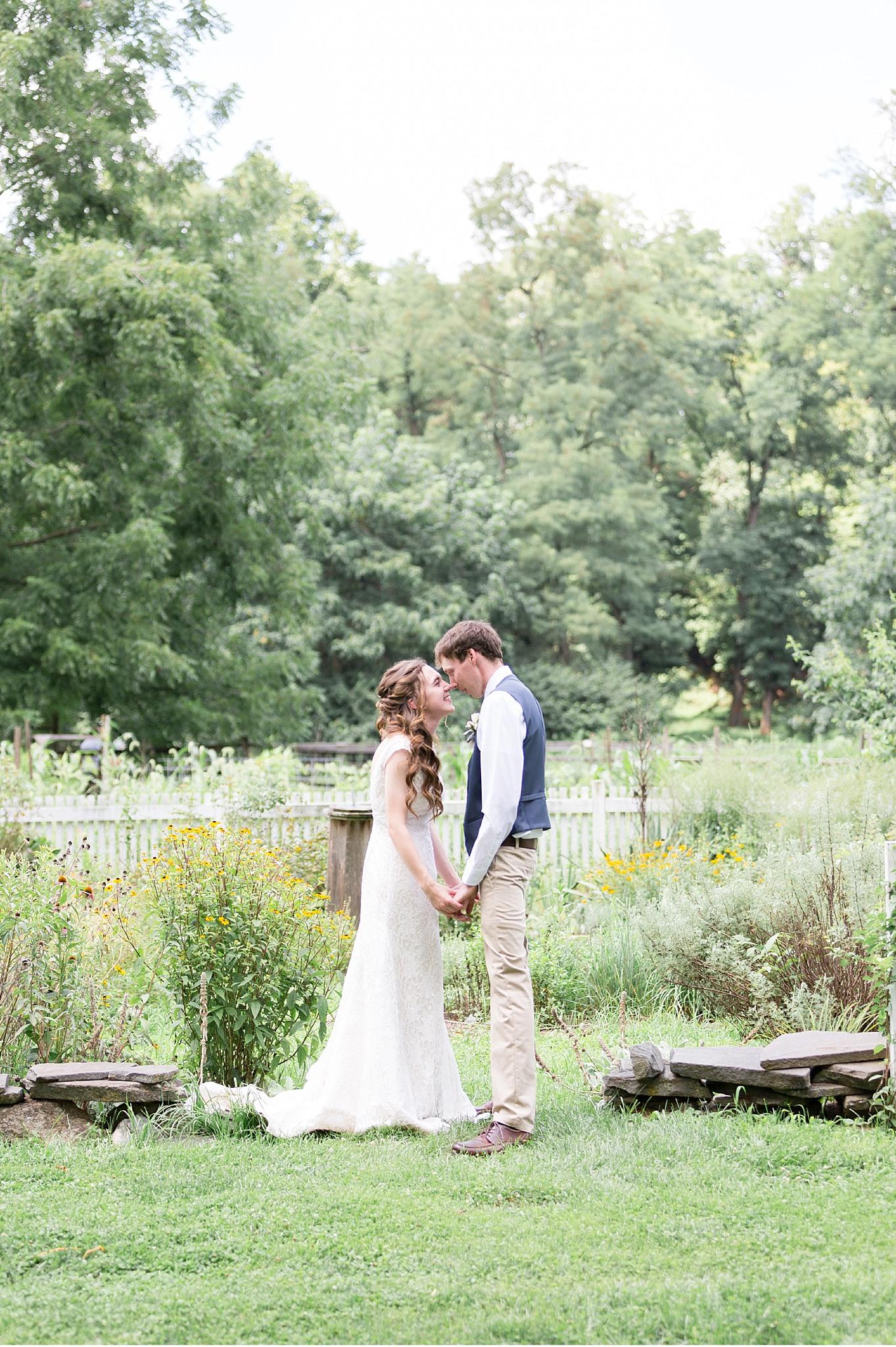 Romantic Summer wedding Landis Valley Museum Lancaster PA wedding photography John Deere Tractor_1968.jpg