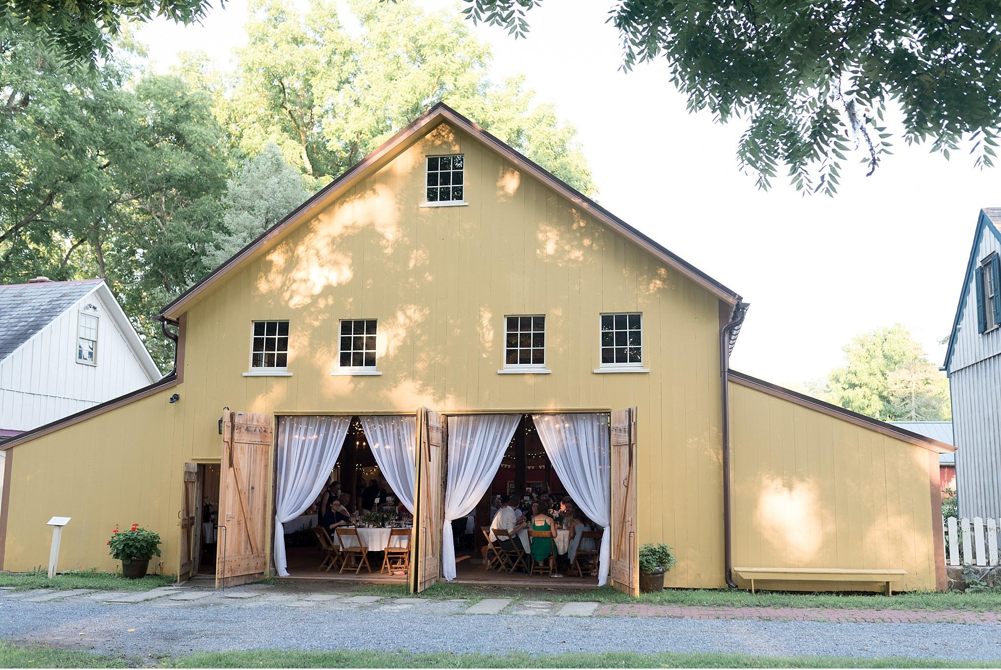 Romantic Summer wedding Landis Valley Museum Lancaster PA wedding photography John Deere Tractor_1985.jpg