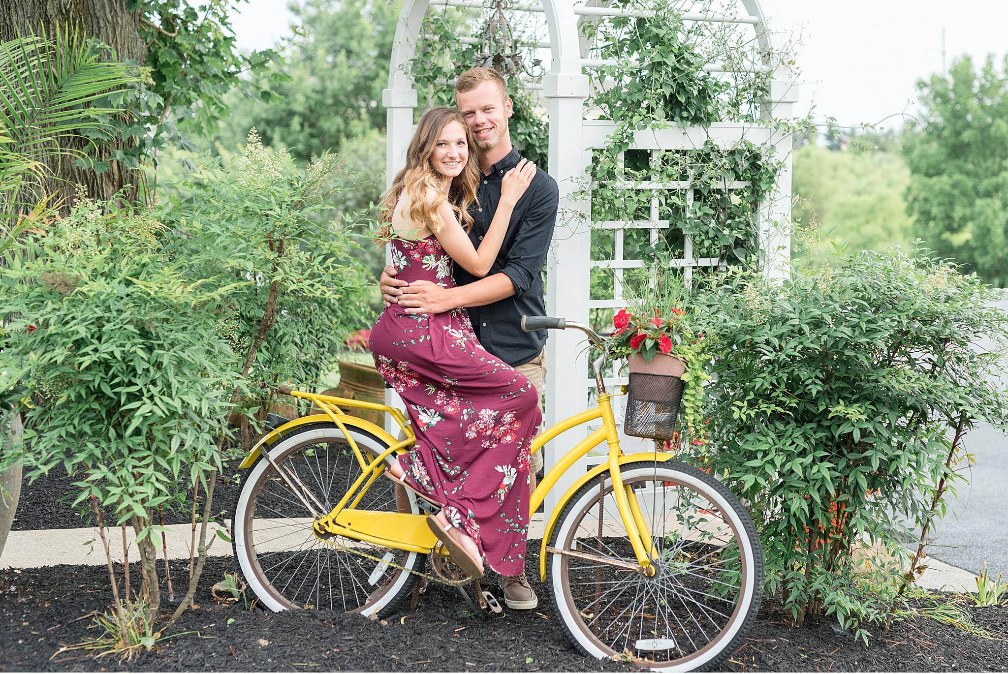 Cedar hollow farm engagement photography bride and groom on yellow bike