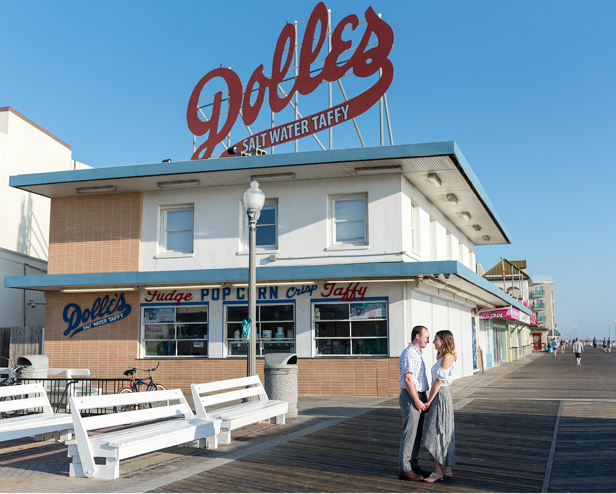 Dolles Rehoboth beach boardwalk engagement session