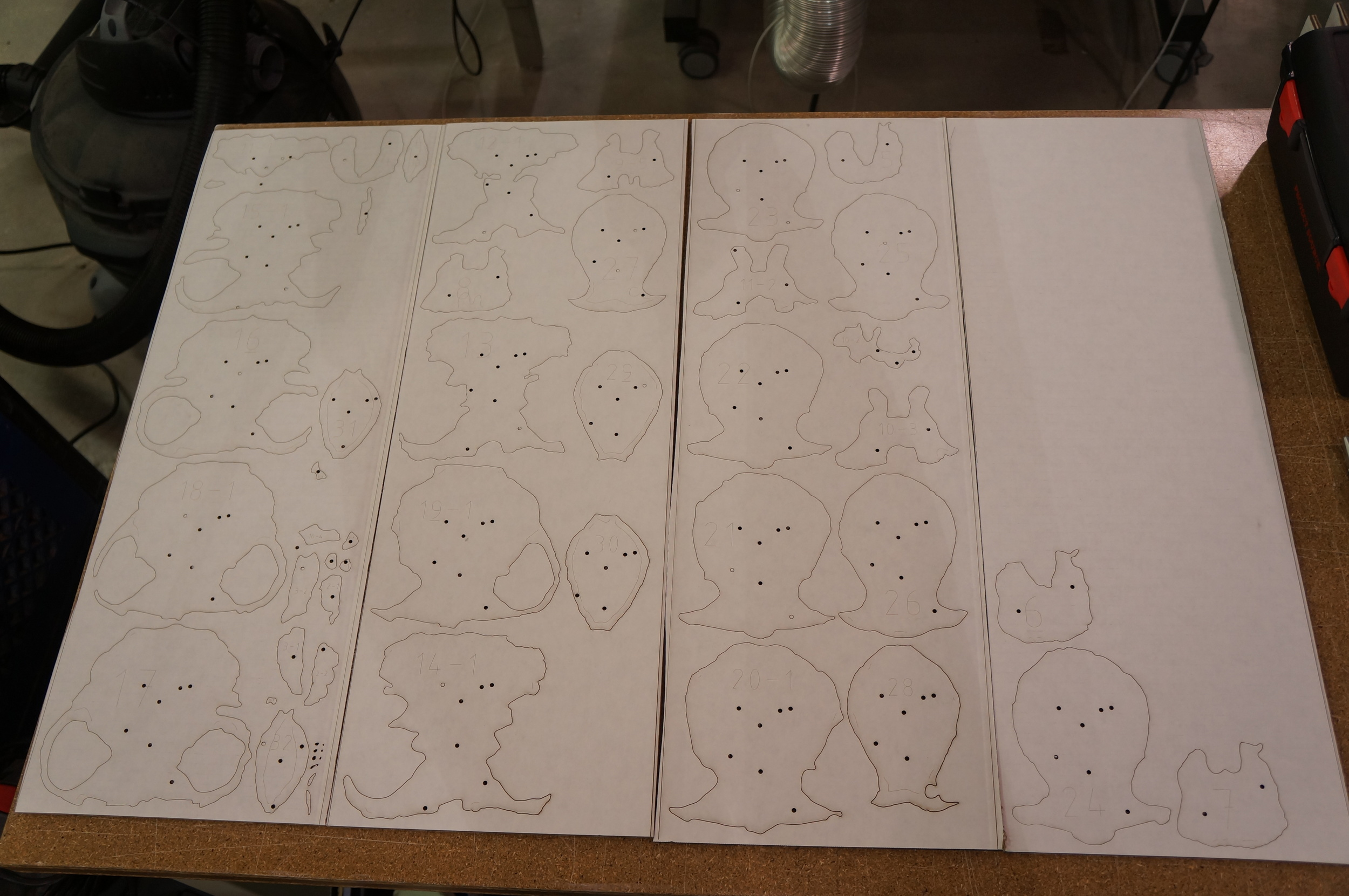 All of the pieces cut out, ready to be assembled. Dark holes are for the bamboo skewers and gluing alignment.