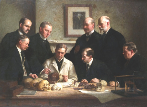 """Group portrait of the Piltdown skull being examined. Piltdown was touted as a """"Missing Link"""" in human evolution, before exposed as a hoax. Painting by John Cooke, 1915."""