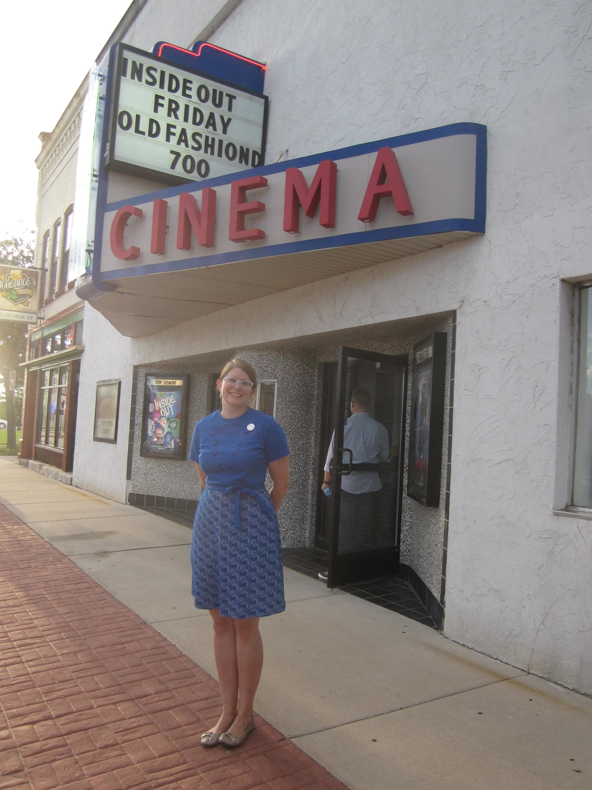 Director, Holly L. De Ruyter, stands outside a a sold out show in De Pere, WI.
