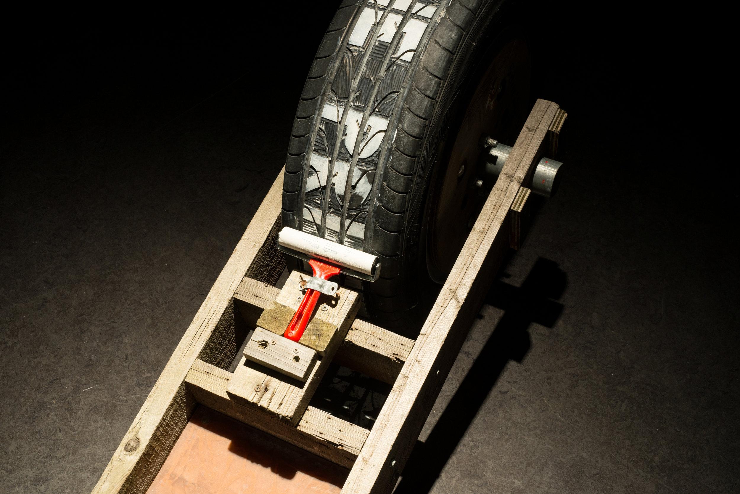Performprint  Printing apparatus, 2014  car tyre, wood, print roller and ink  dimensions variable (detail)