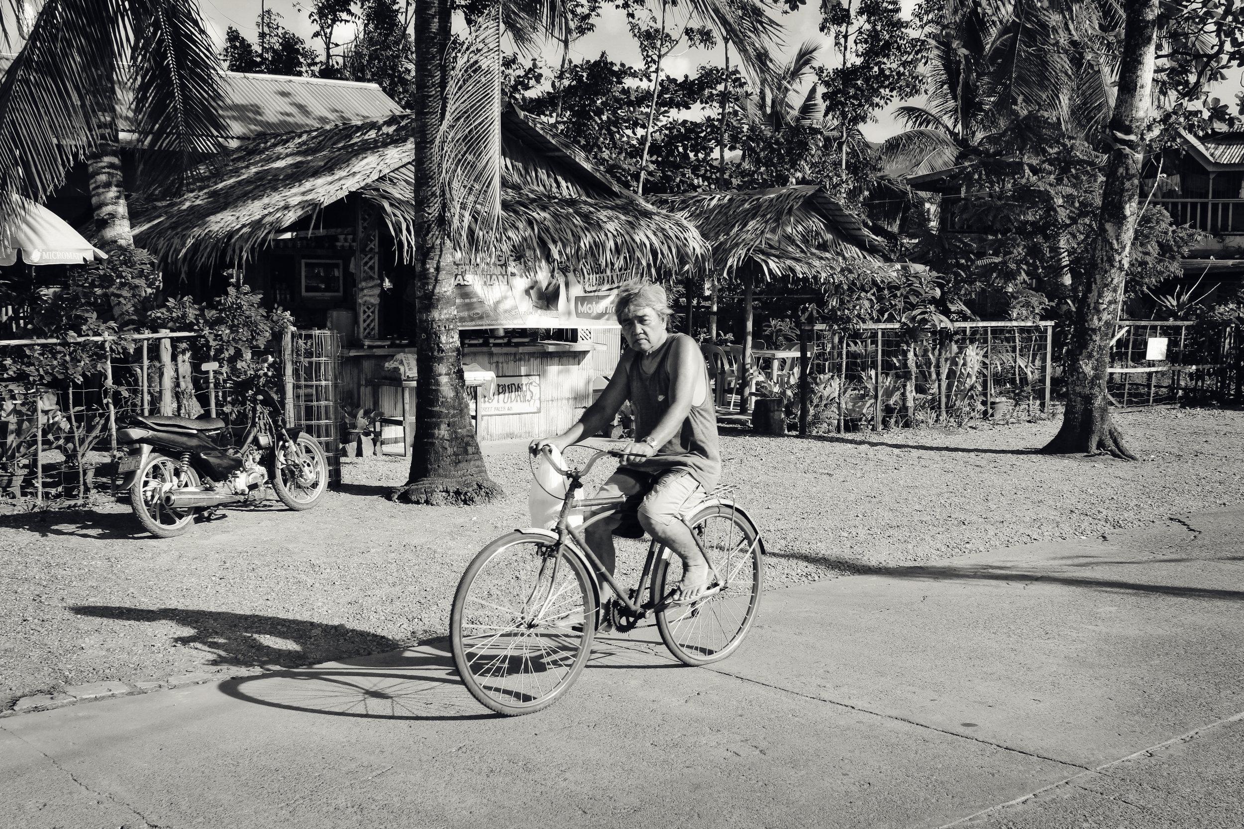 Philippino Man on Bike.jpg