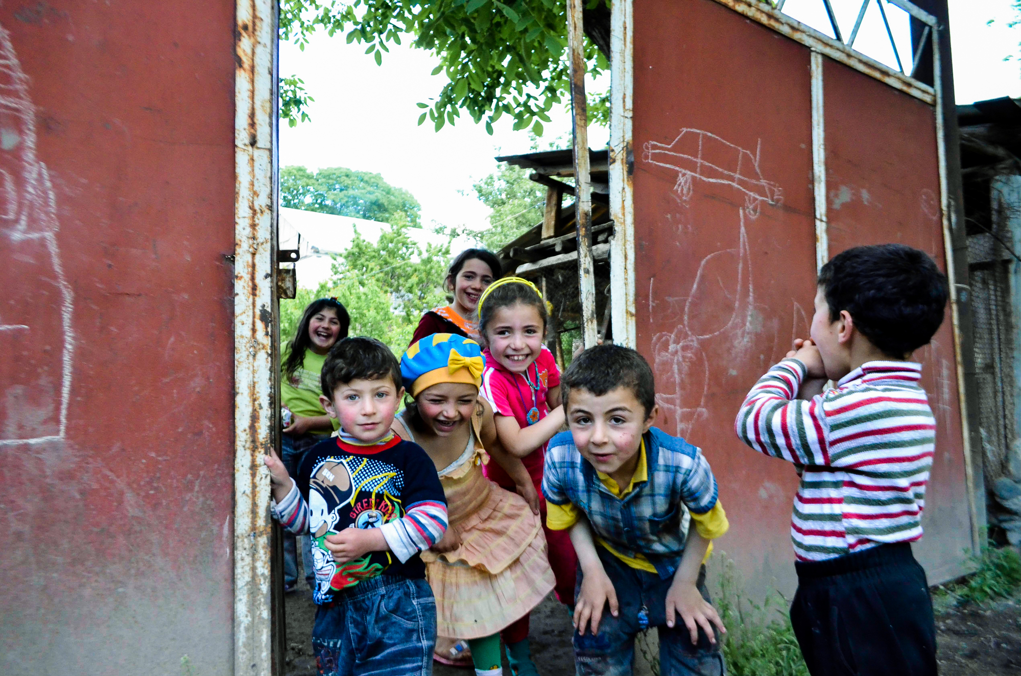 Some children giggle at the site of foreigner in the mountain village of Garatomb.