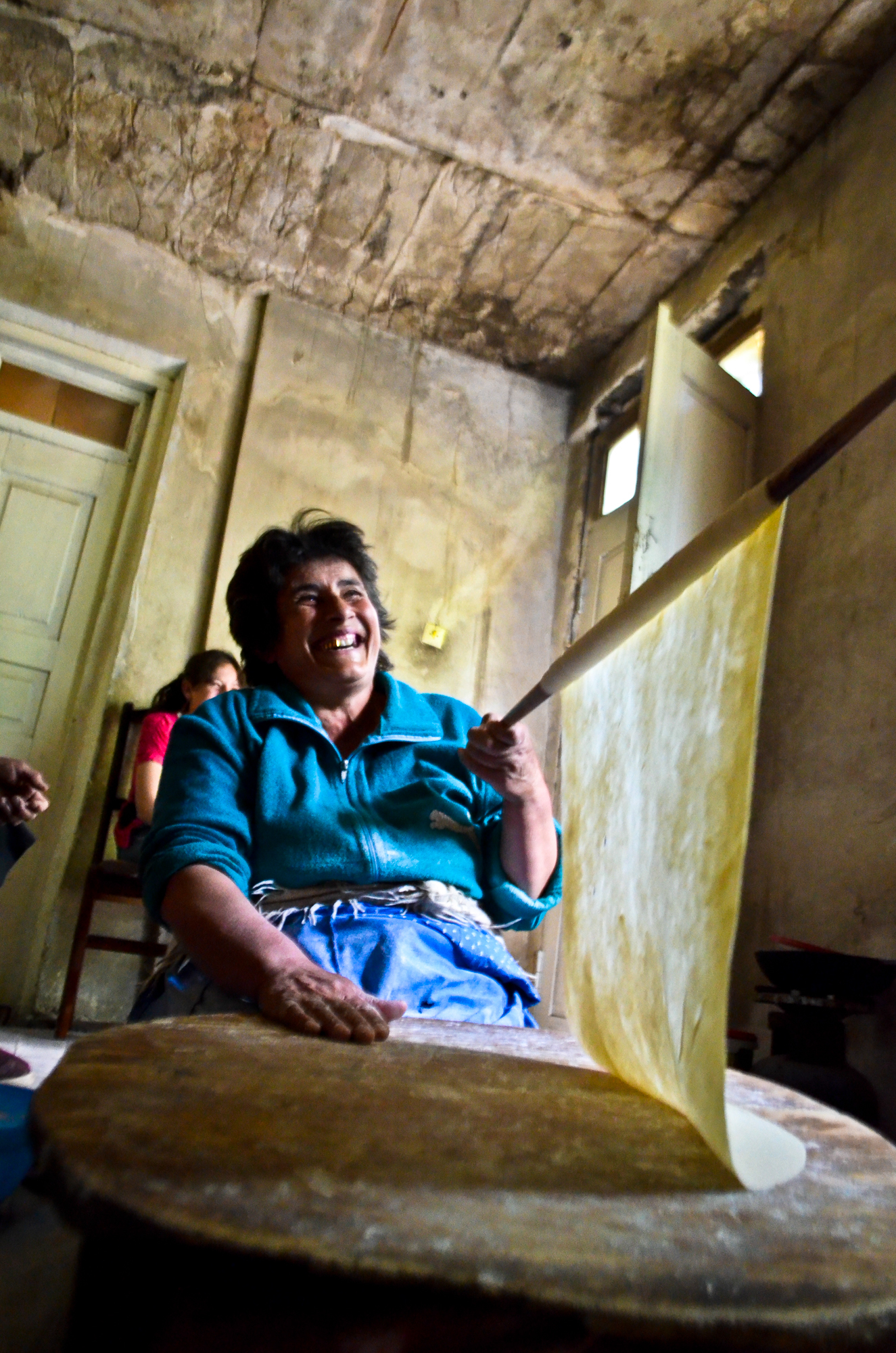 A woman makes lavash (a flat type of bread) in the village of  Garatomb, Armenia.