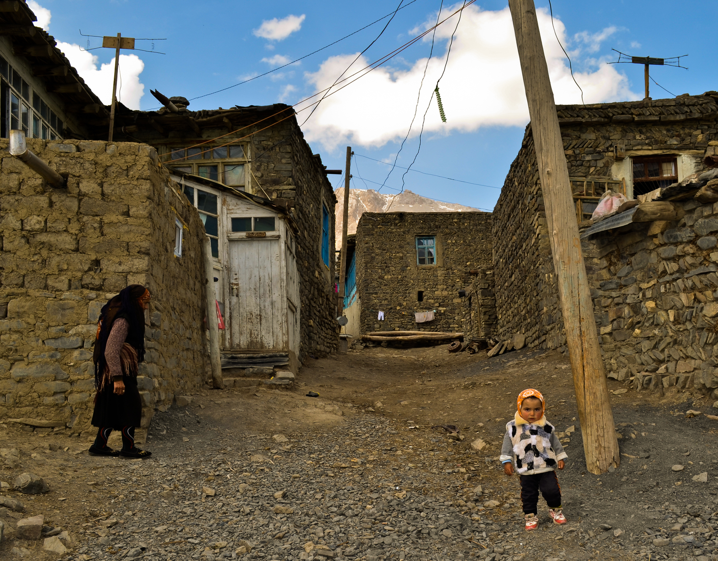 Elderly woman and child in Xinaliq, Azerbaijan.