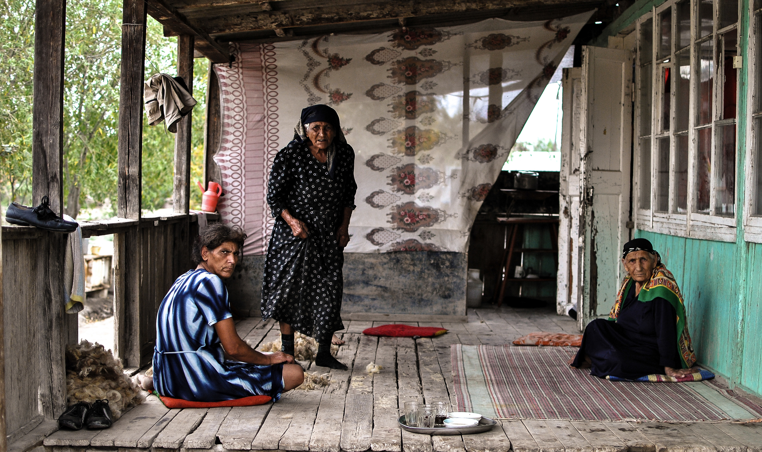 Women on the patio of their flood ravaged home in the village of Sabirabad, Azerbaijan.