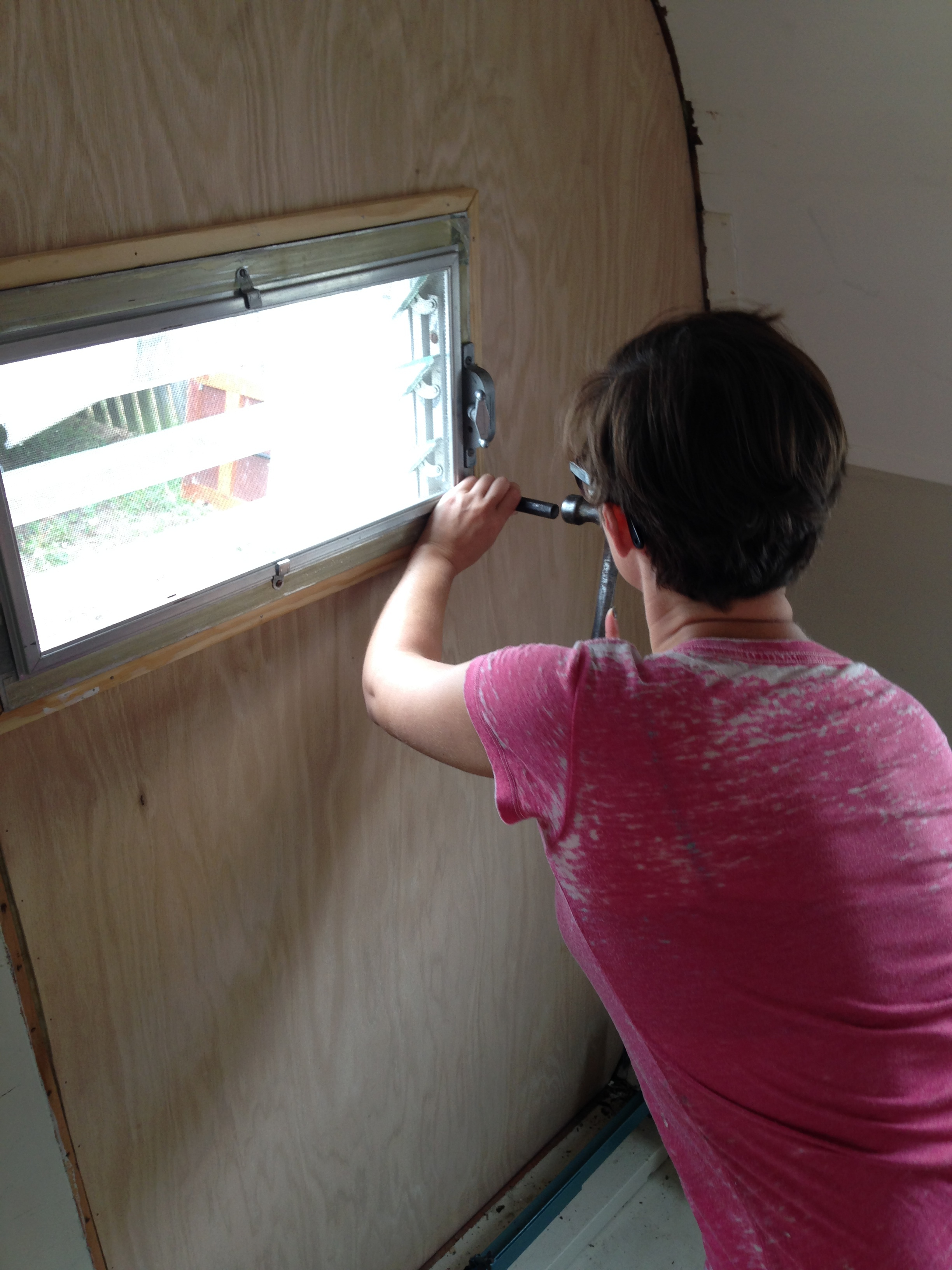 Sarah making new window frames.