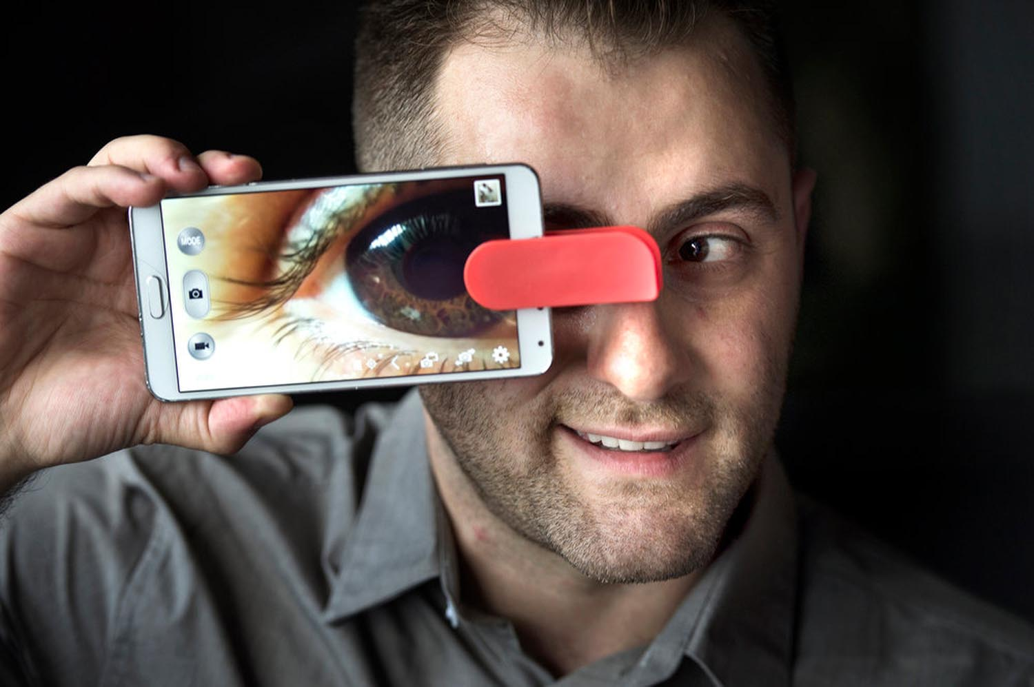 Aris Allahverdian, inventor, CEO of Mobi-Lens, shows his product. The lenses (wide angle, fish eye, macro) clip on to any smart device. The universal design fits over any smart device on front or back camera.