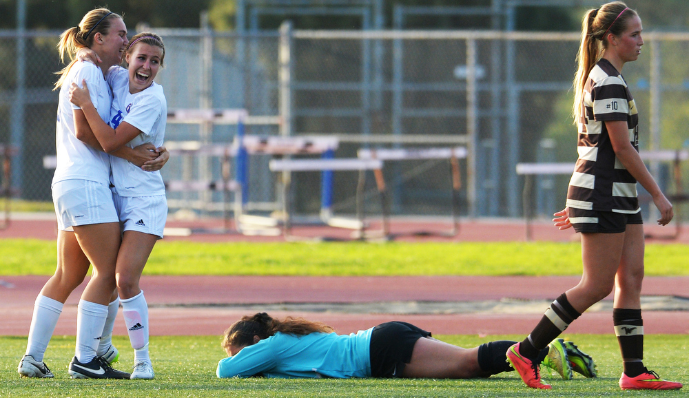 La Mirada's Madison Bennett(4) celabrates her game winning goal with teammate Aubrey Baran(28) as West Torrance's Ruth Soto, goal keeper,  lies on the ground in CIF State Division II first round high school girls soccer in La Mirada CA. Tuesday March 10, 2015.  La Mirada went on to win the game in OT 1-0.
