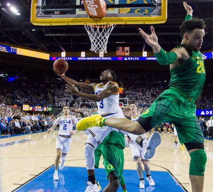 UCLA guard Aaron Holiday (3) pushes past Oregon forward Dillon Brooks (24) to score a layup at Pauley Pavilion in Los Angeles, Calif. on Feb. 9, 2017. Holiday's layup started a seven-point scoring streak for the Bruins that turned the lead to UCLA in the final minutes, winning them the game 82-79.
