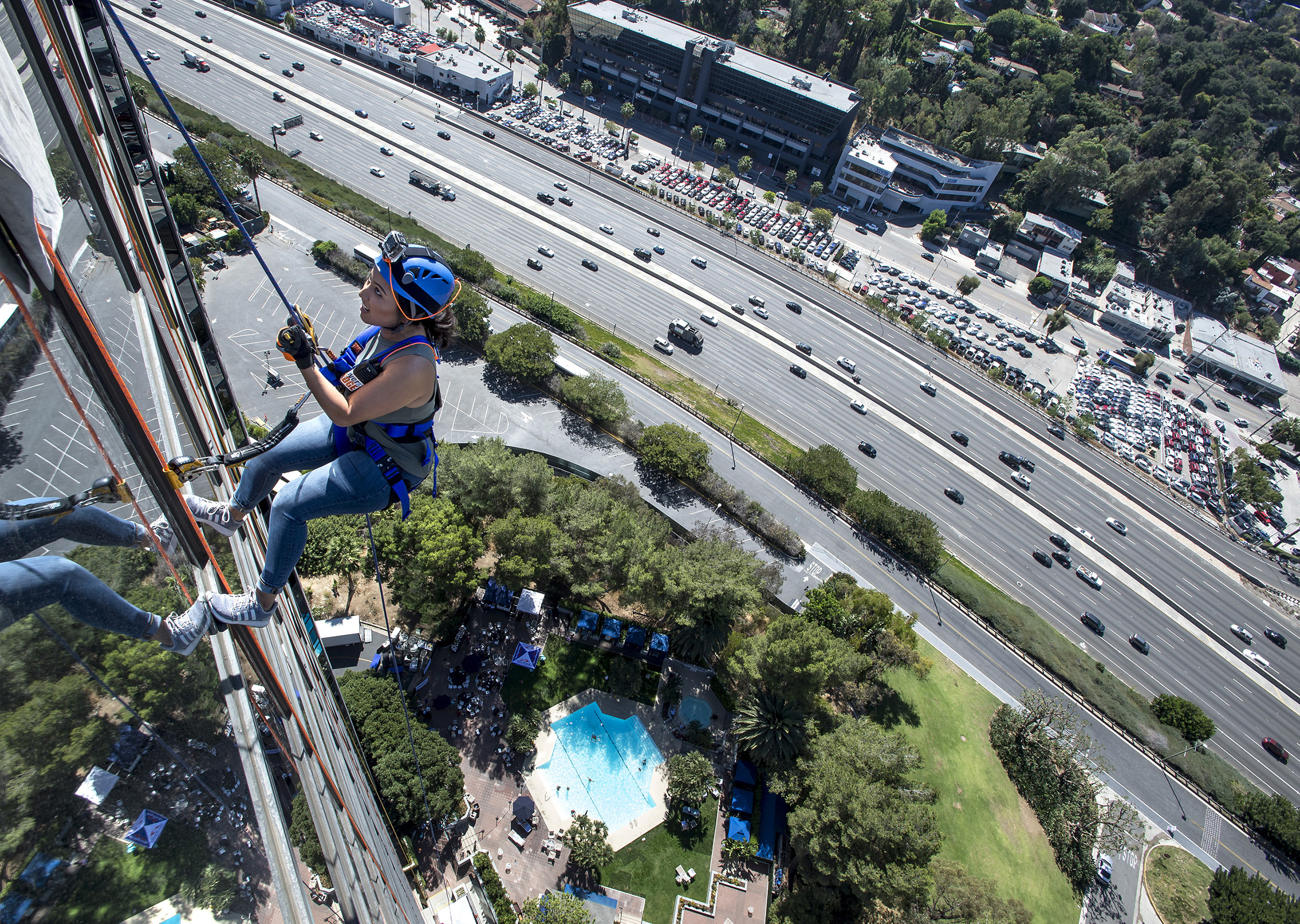 Ruby Olmos, of Santa Clarita, rappels over the edge at the Universal City Hilton Hotel to raise funds for Homes 4 Families in Universal City on Saturday, Oct. 07, 2017. Homes 4 Families' mission is to build resiliency, economic growth, neighborhoods, and homes for veteran families according to press release.