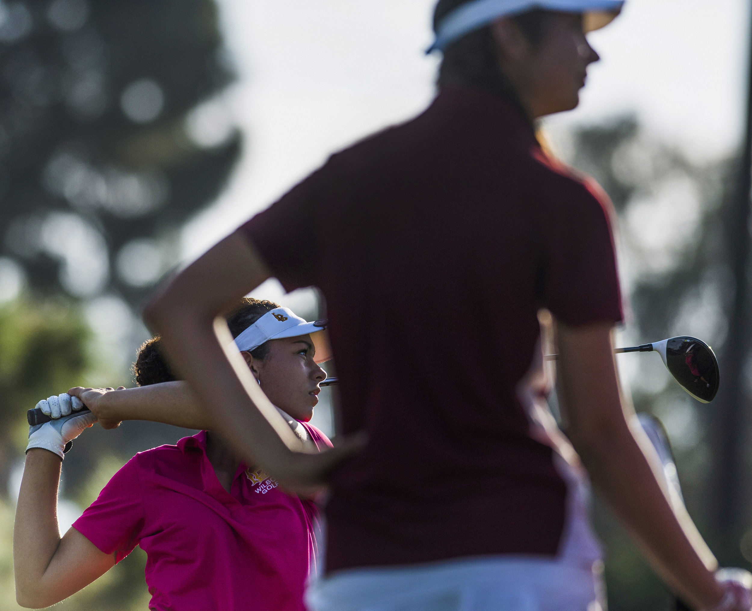Wilson�sOlivia Renville, left, tees off on the 18th hole as teammate Hannah Vos looks on as the Wilson girls golf dominates in the Moore League Individual Tournament in Long Beach Wednesday, October 18, 2017.