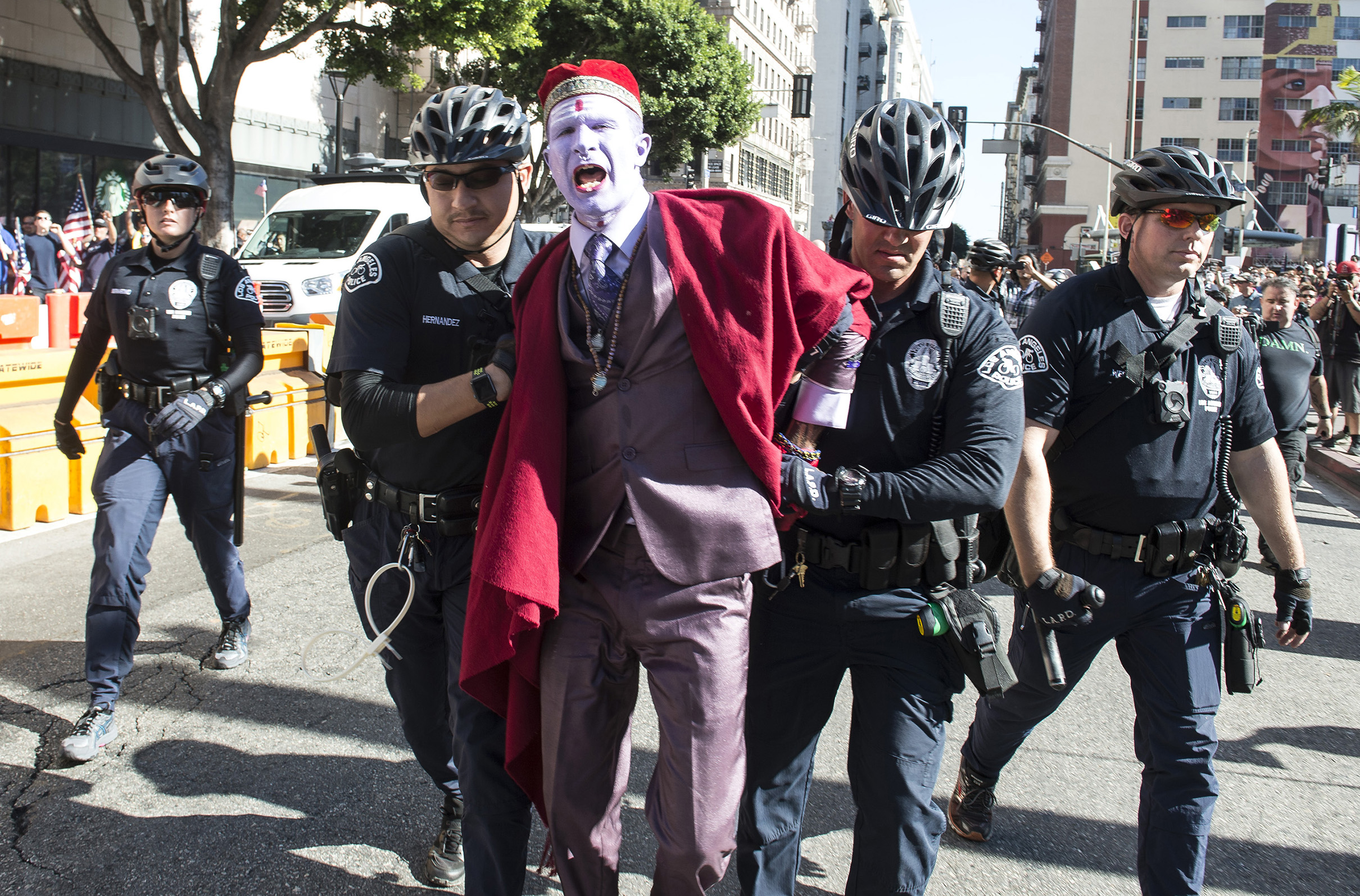 """Henry Walters is taken into custody by LAPD police officers on suspicion of attempting to incite a riot during """"This Nightmare Must End: the Trump/Pence Regime Must Go!"""" protest in downtown Los Angeles on Saturday, Nov. 4, 2017. A protest against President Donald Trump drew a group of counter-demonstrators to downtown Los Angeles with the two groups kept apart by police."""