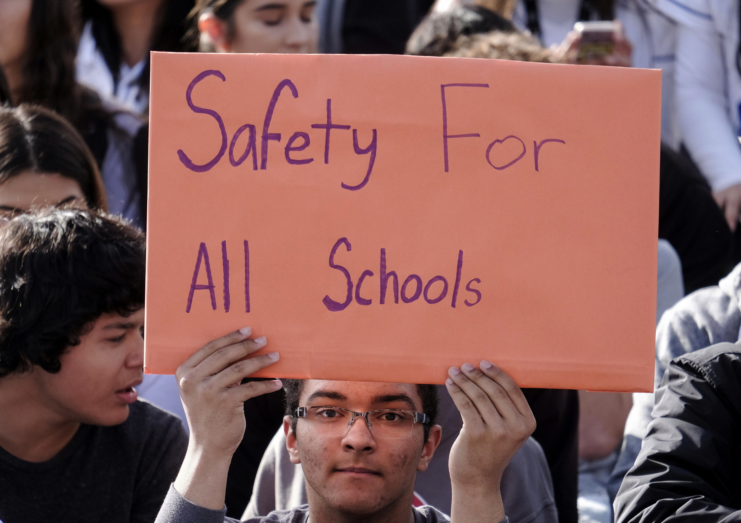 A student from Francis Polytechnic High School holds up a sign during ``#NeverAgain,'' an assembly which spotlights the meaning of school safety for students as part of a nationwide protest against gun violence, Wednesday, March 14, 2018, in Los Angeles.