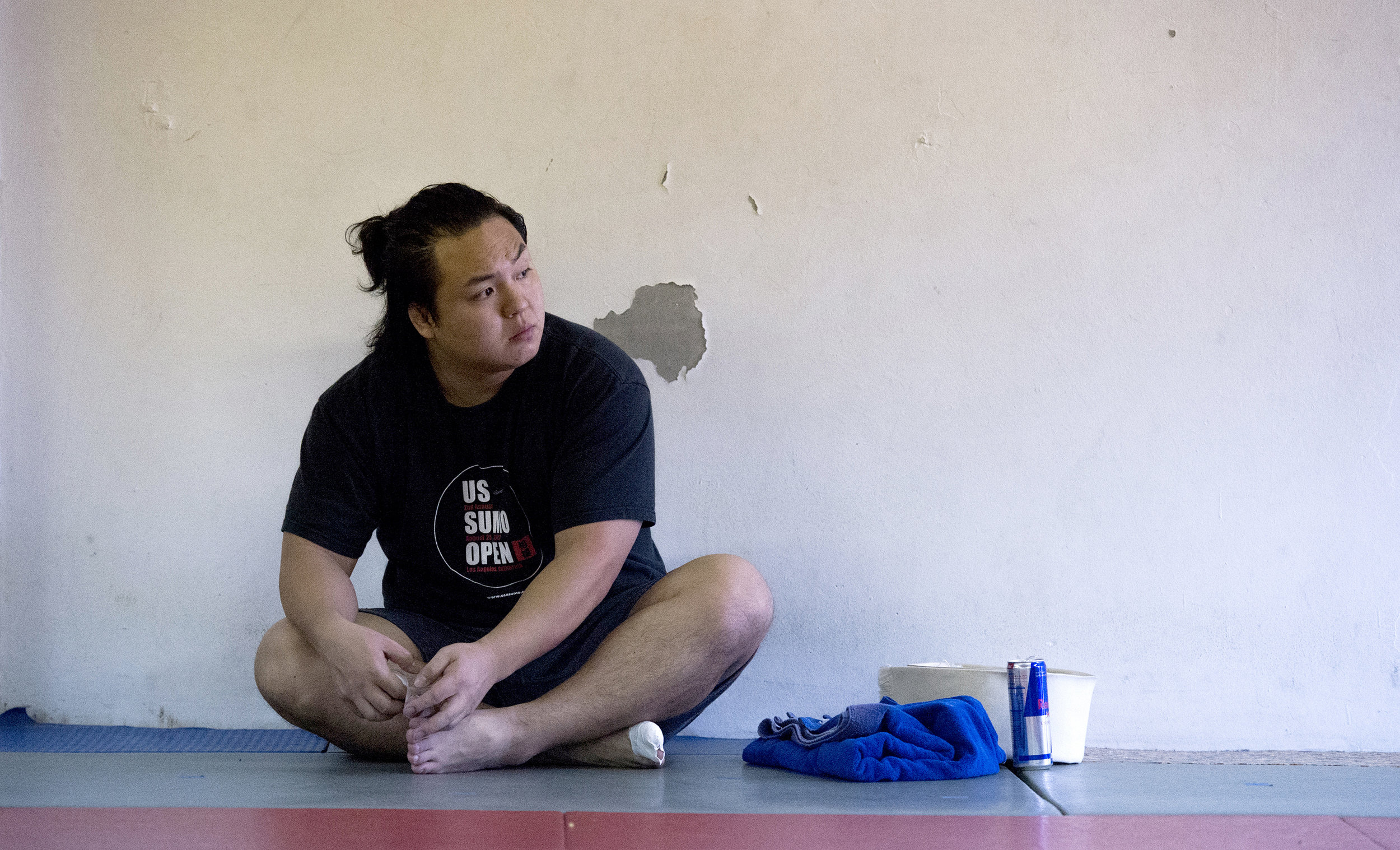 Takeshi Amitani, of Japan, tapes up his toes before a sumo wrestling practice in Carson Sunday, April 8, 2018.  Amitani coaches and trains sumo wrestling and is a 5-time Japanese National University Champion, he also was the undefeated Openweight champion in the  US Sumo Open last year.